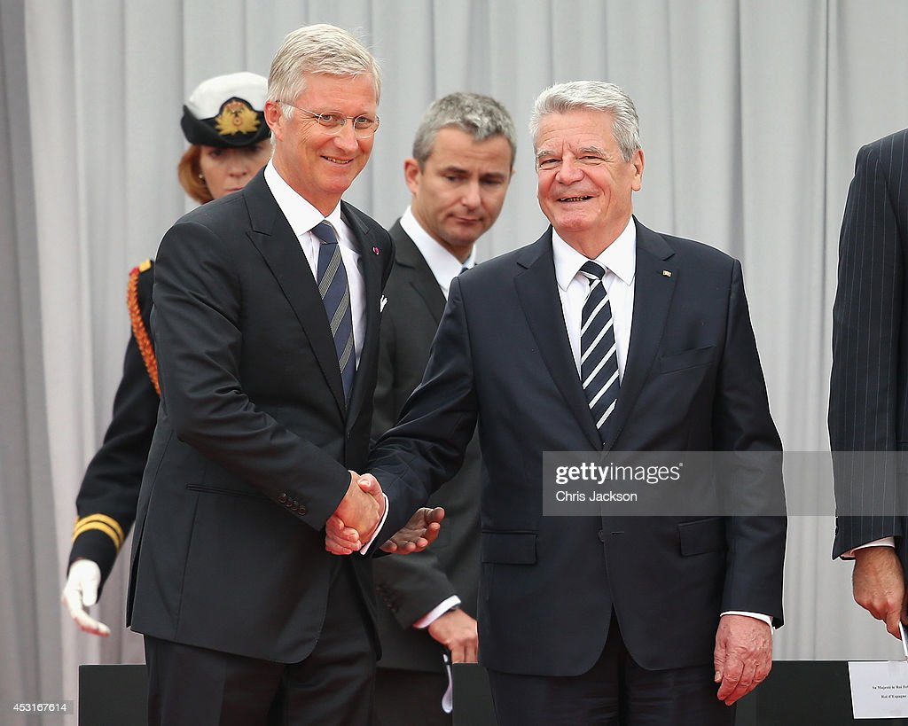 German President Joachim Gauck shakes hands with Francois Hollande as they attend a WW1 100 Years Commomoration Ceremony at Le Memorial Interallie on August 4, 2014 in Liege, Belgium. Monday 4th August marks the 100th Anniversary of Great Britain declaring war on Germany. In 1914 British Prime Minister Herbert Asquith announced at 11pm that Britain was to enter the war after Germany had violated Belgium's neutrality. The First World War or the Great War lasted until 11 November 1918 and is recognised as one of the deadliest historical conflicts with millions of casualties. A series of events commemorating the 100th Anniversary are taking place throughout the day.