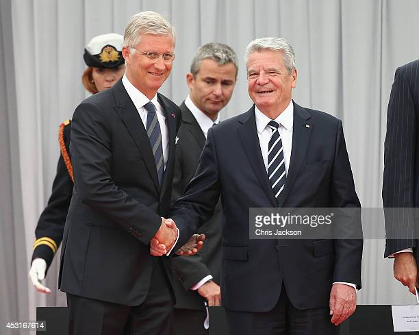 German President Joachim Gauck shakes hands with Francois Hollande as they attend a WW1 100 Years Commomoration Ceremony at Le Memorial Interallie on...