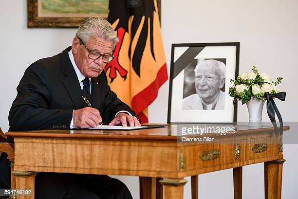 German President Joachim Gauck signs a book of condolence for former President of West Germany Walter Scheel at Bellevue presidential palace on...