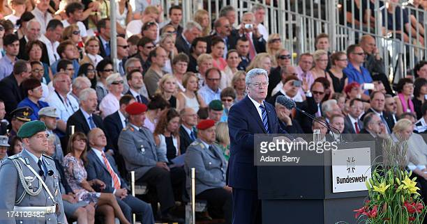 German President Joachim Gauck speaks at a swearingin ceremony for new recruits of the Bundeswehr the armed forces of the Federal Republic of Germany...