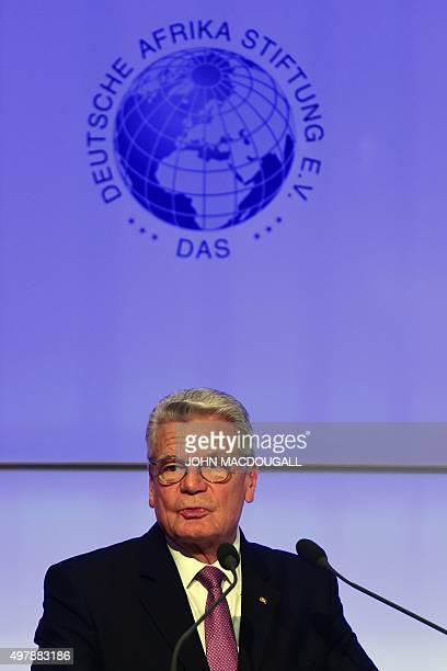 German President Joachim Gauck speaks before Tunisian National Dialogue Quartet member and Secretary General of the Tunisian General Labour Union...
