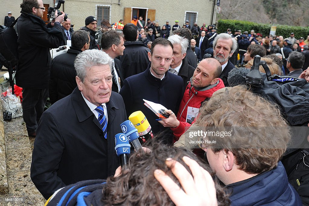 German president Joachim Gauck speaks to the media as he pays his respects to the victims of the Sant'Anna Di Stazzema Nazi Massacre on March 24, 2013 in Sant'Anna di Stazzema, near Lucca, Italy. The heads of state paid homage to the 560 victims of the Nazi massacre which took place on August 12, 1944. The ceremony was also attended by survivors and relatives of the victims.