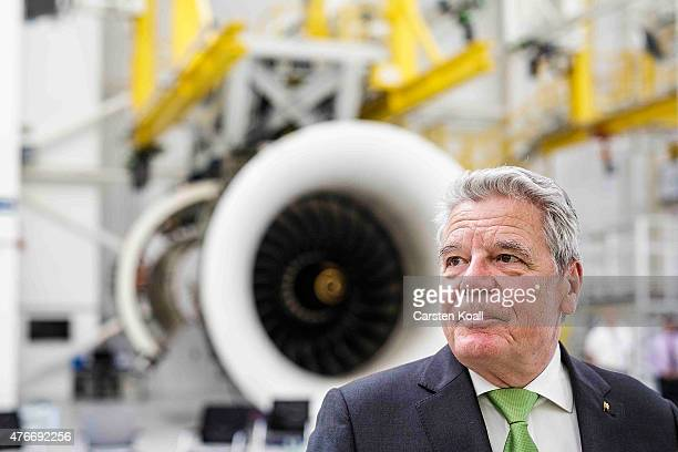 German President Joachim Gauck speaks to the media while visiting the RollsRoyce Mechanical Testing Operations Center on June 11 2015 near Berlin...