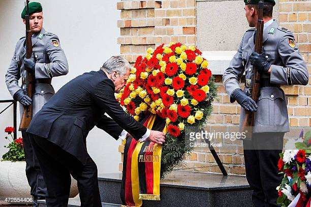 German President Joachim Gauck stands in front of a wreath at a cemetery and memorial to Soviet Red Army soldiers killed during World War II to...