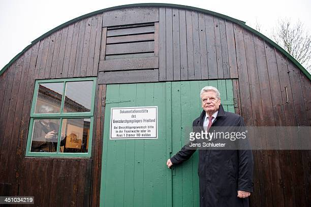 German President Joachim Gauck stands in front of the museum at a refugee center on November 21 2013 in Friedland Germany Germany is accepting up to...