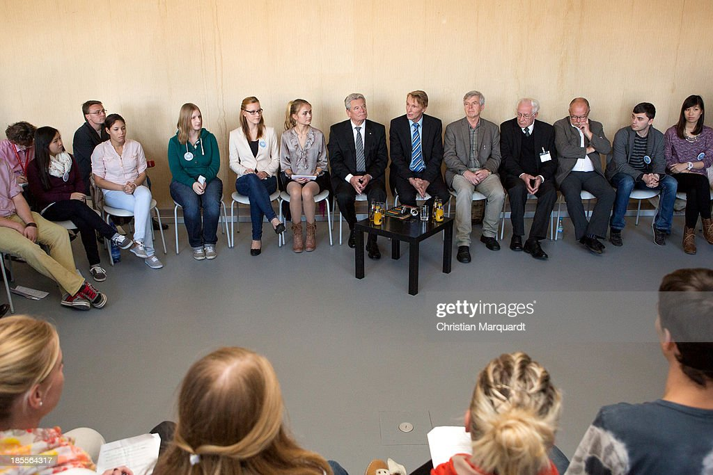German President Joachim Gauck talks to students during his visit at the 'Gedenkenstaette Berlin Hohenschoenhausen' on October 22, 2013 in Berlin, Germany. 'Hohenschoenhausen' was the remand prison for people detained by the former East German Ministry for State Security (MfS) or 'Stasi' and has been a Memoral since 1994.