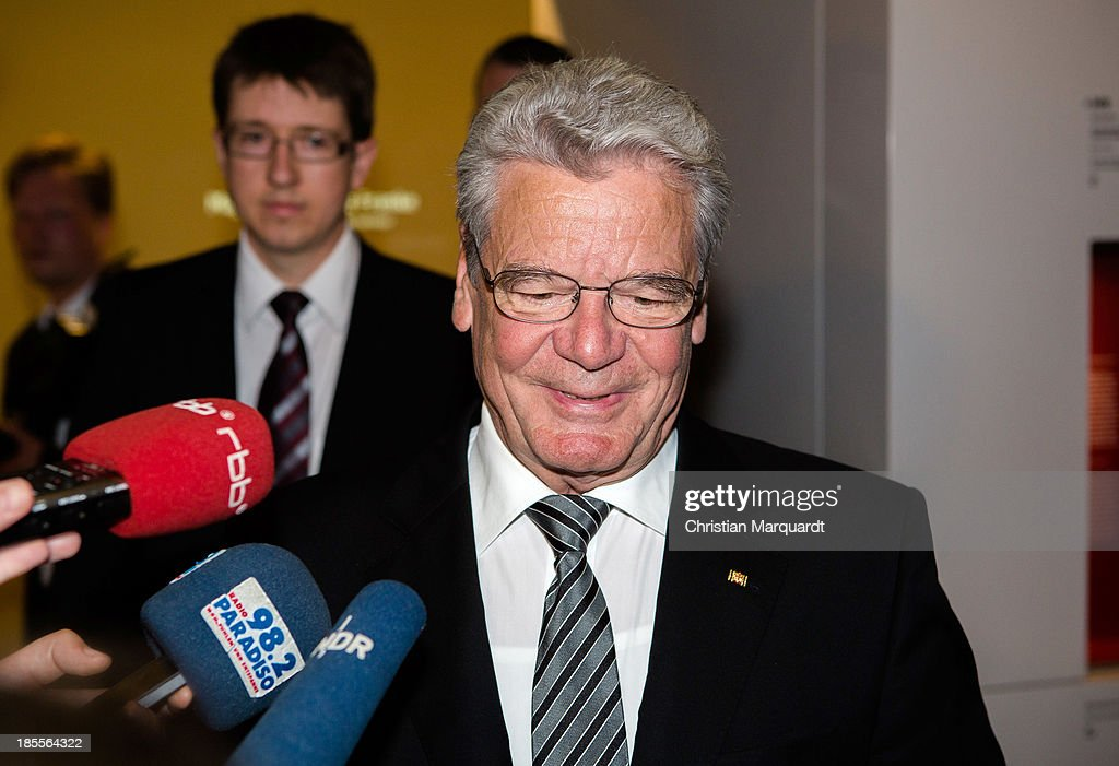 German President Joachim Gauck talks to the media during his visit of the exhibition on October 22, 2013 in Berlin, Germany. 'Hohenschoenhausen' was the remand prison for people detained by the former East German Ministry for State Security (MfS) or 'Stasi' and has been a Memoral since 1994.