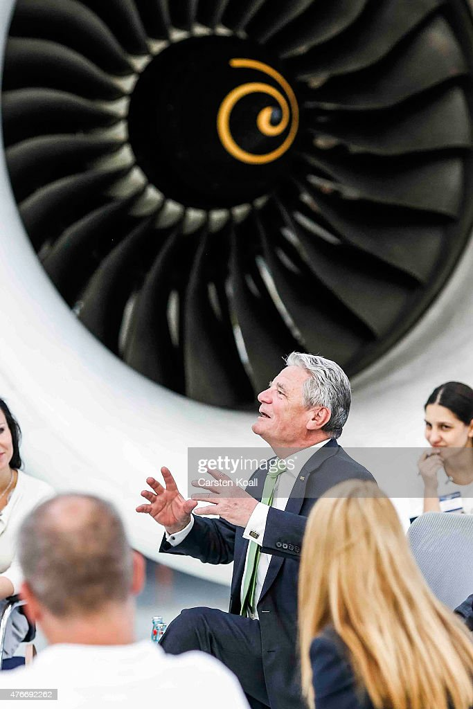 German President Joachim Gauck talks with employees while visiting the Rolls-Royce Mechanical Testing Operations Center on June 11, 2015 near Berlin, Germany. Gauck was visiting the center to learn about its integration of immigrants among its workforce.