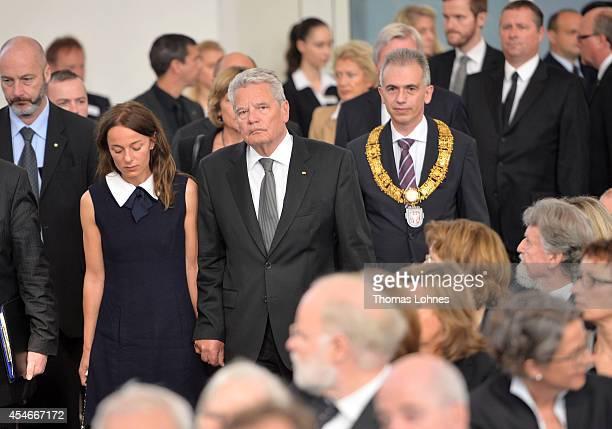 German President Joachim Gauck , the widow of Frank Schirrmacher Rebecca Casati and Frankfurts major Peter Feldmann attend a service of commemoration...