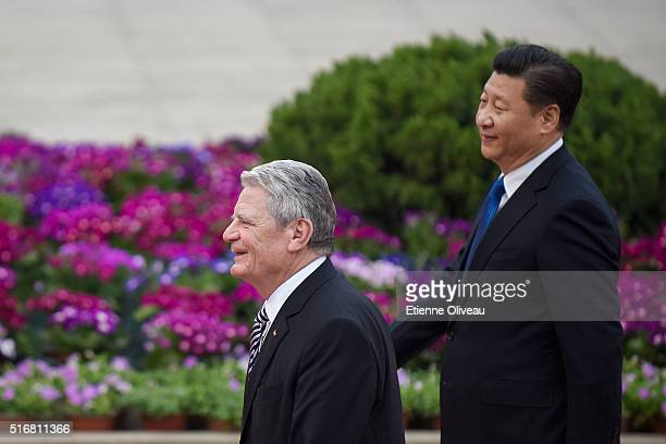 German President Joachim Gauck walks with Chinese President Xi Jinping at the Great Hall of the People on March 21, 2016 in Beijing, China. At the...