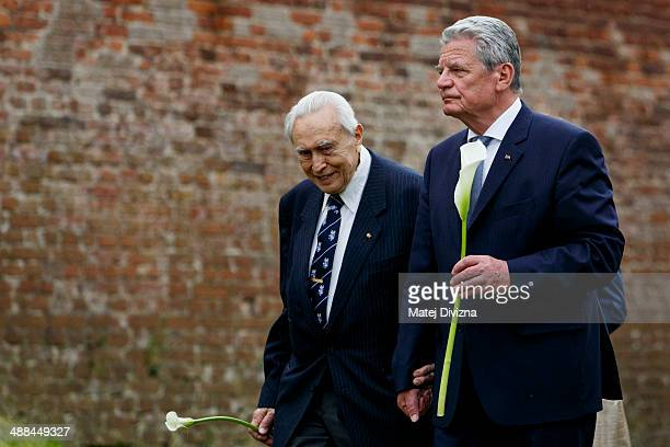 German President Joachim Gauck walks with holocaust survivor Felix Kolmer during their visit at the Terezin Memorial on May 6 2014 in Terezin Czech...