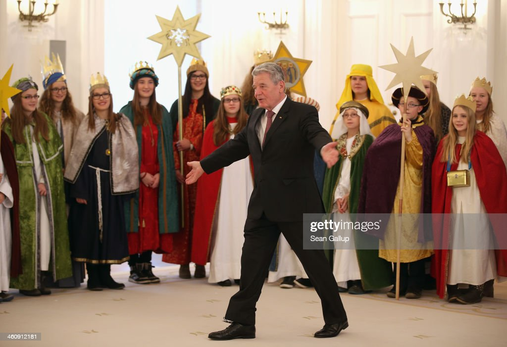 German President Joachim Gauck welcomes children Epiphany carolers dressed as the Three Kings at Schloss Bellevue palace on January 6, 2014 in Berlin, Germany. Children across Germany dressed as the Three Kings traditionally go from house to house between the end of December and Epiphany to sing and collect donations for cahritable causes.