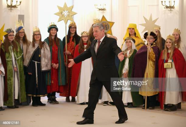 German President Joachim Gauck welcomes children Epiphany carolers dressed as the Three Kings at Schloss Bellevue palace on January 6, 2014 in...