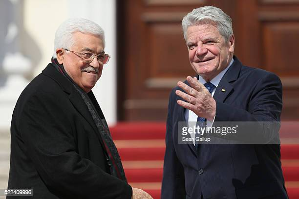 German President Joachim Gauck welcomes Palestinian President Mahmoud Abbas at Schloss Bellevue palace on April 19 2016 in Berlin Germany Abbas is...