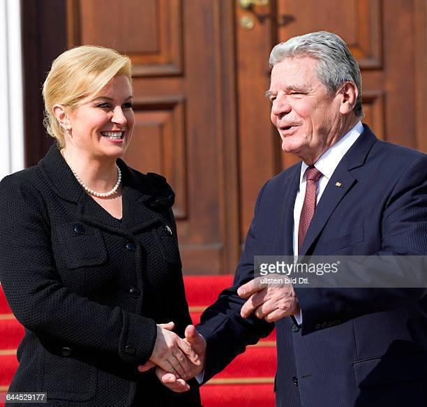 German President Joachim Gauck welcomes the Croatian President Kolinda GrabarKitarovic with military honors on March 17 2015 at presidential Bellevue...