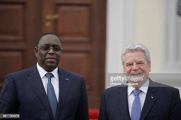 German President Joachim Gauck welcomes the President of Senegal Macky Sall in Bellevue Palace on March 31 2014 in Berlin Germany President Macky...