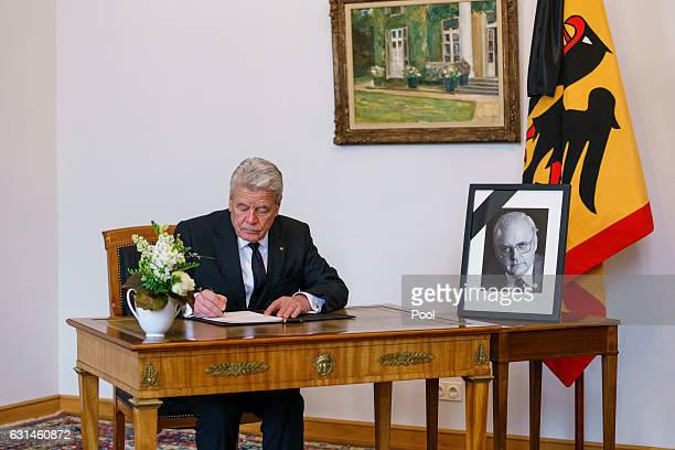 German President Joachim Gauck writes an entry in the book of condolence for the family of Former German President Roman Herzog at Bellevue Palace on...