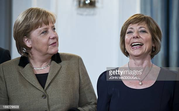 German President Joachim Gauck's partner Daniela Schadt chats with German Chancellor Angela Merkel during an annual New Year reception at the...