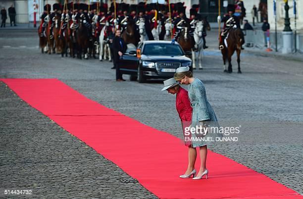 TOPSHOT German President Joachim Gauck's partner Daniela Schadt is welcomed by Belgium Queen Mathilde during an official welcoming ceremony at the...
