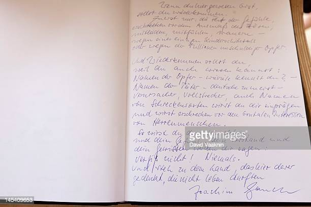 German President Joachim Gauck's signature and notes are displayed in the guest book at the Yad Vashem Holocaust memorial on May 29 2012 in Jerusalem...