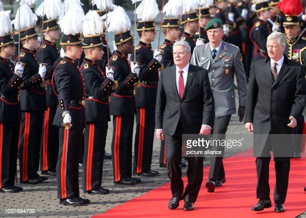 German President JoachimGauck is received with military honours by King Philippe of Belgium inBrussels Belgium 08 March 2016 Gauck is on a...