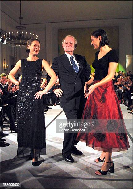 German President Johannes Rau joins his wife Christina and his daughter Anna Christina at a charity fashion show to benefit UNICEF