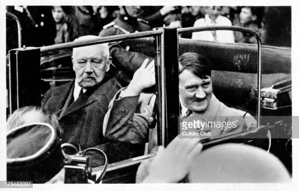 German President Paul von Hindenburg in a car with Nazi leader and Chancellor of Germany Adolf Hitler on their way to a Labour Day youth rally at the...