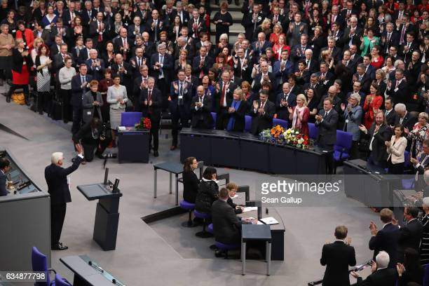 German Presidentelect FrankWalter Steinmeier waves after he gave a speech following his election as new German president by the Federal Assembly at...