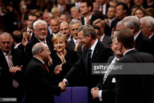 German presidential candidate Christian Wulff is congratulated by leftwing political party Die Linke Bundestag faction head Gregor Gysi as German...