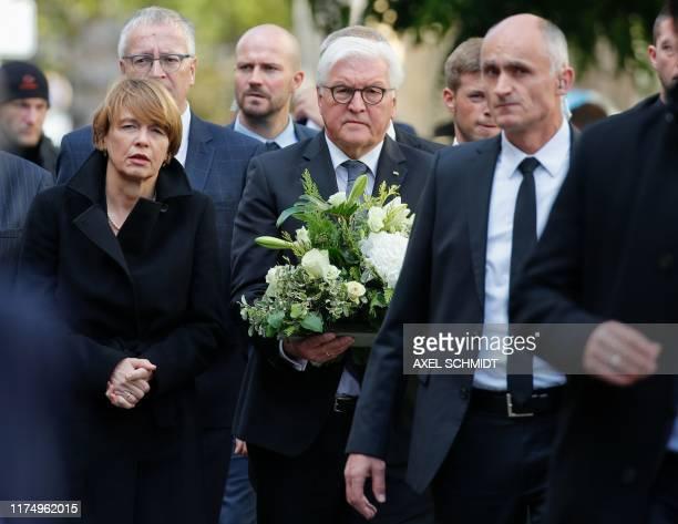 German President's wife Elke Buedenbender and German President FrankWalter Steinmeier arrive at the synagogue in Halle eastern Germany on October 10...