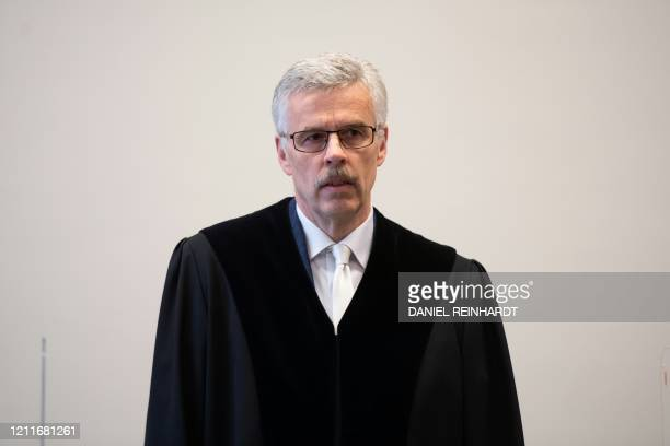 German presiding judge Norbert Sakuth arrives to the courtroom for the start of the trial of a GermanTunisian woman who married a German rapper...