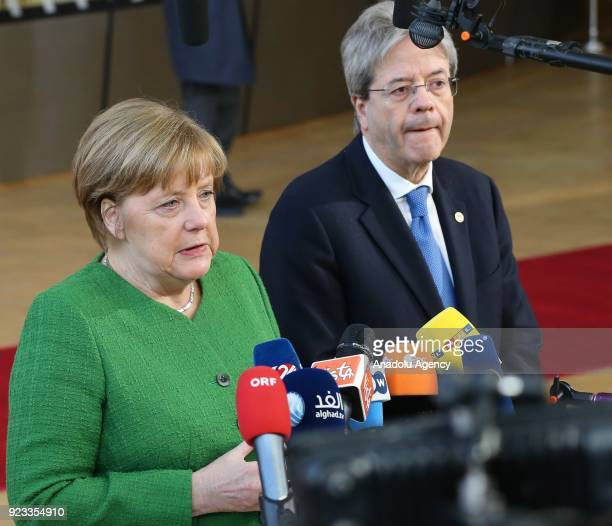 German Prime Minister Angela Merkel and Italian Prime Minister Paolo Gentiloni answer the questions of press members as they arrive to attend the EU...
