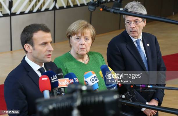 German Prime Minister Angela Merkel French President Emmanuel Macron and Italian Prime Minister Paolo Gentiloni answer the questions of press members...