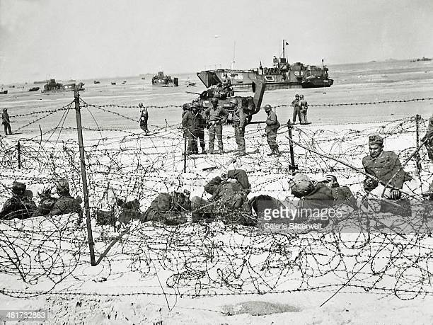German prisoners are kept in an enclosure with barbed wire 6th June 1944 They will later be taken to camps in England Utah Beach Normandy France