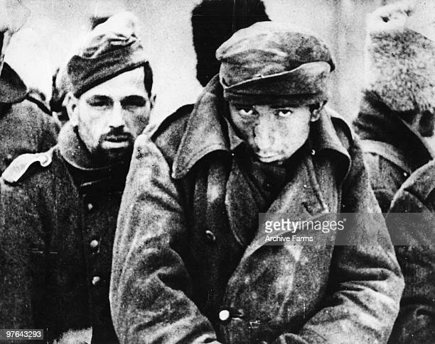 German prisoners huddle with soldiers from other Axis satellite countries against the sharp winds of the Russian winter after the defeat ot the...