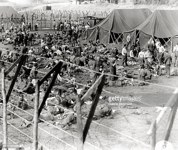 German Prisoners of War are confined within a camp June 1944 Some tents have been set up IsignysurMer Normandy France