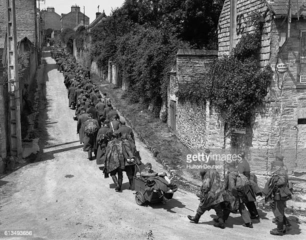 German prisoners of war are marched though Cherbourg after the liberation of the town by the Allies ca 1944