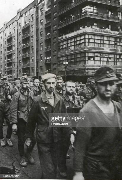 German prisoners of war, numbering 57 are marched through the streets on Moscow on their way to prisoner-of-war camps, Moscow, Russia, July 17, 1944.