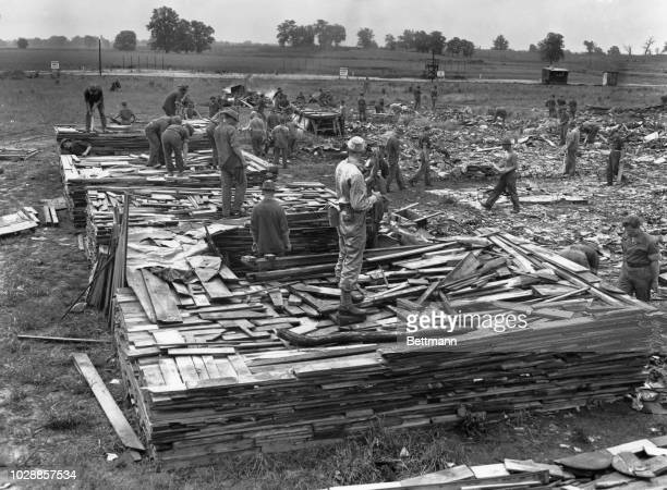 German prisoners of war wrecking an old house in the internment area at Camp Breckinridge