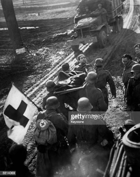 German prisoners surrender with the aid of a Red Cross flag during the Allied advance along the Western battle front