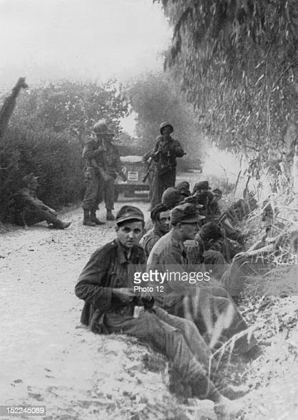 German prisoners taken in the first dawn surprise attack after Americans troops had landed on the northern Sicily coast behind enemy lines beyond San...