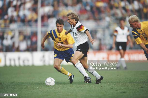 German professional footballer Jurgen Klinsmann forward with Inter Milan pictured making a run with the ball for the Germany team as Swedish defender...