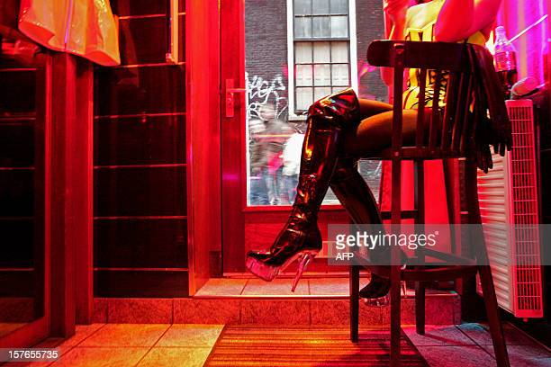 German prostitute, called Eve, waits for clients behind her window in the red light district of Amsterdam on December 8, 2008. Under a plan called...