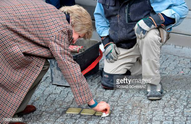 German publisher and main owner of the Axel Springer media conglomerate Friede Springer polishes stumbling stones for Holocaust victims Amalie Lax,...