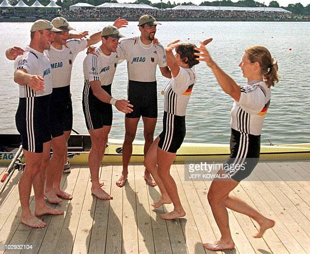 German quadruple scull rowers Manuela Lutze and Kerstin Kowalski greet the German men quadruple scull rowers Andreas Hajek Marco Geisler Stephan...