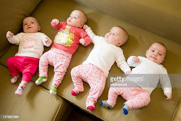 German quadruplets Sophie Jasmin Laura and Kim Mehnert lay on a sofa during their first holiday at a family farm on June 20 2012 in Lilienthal near...
