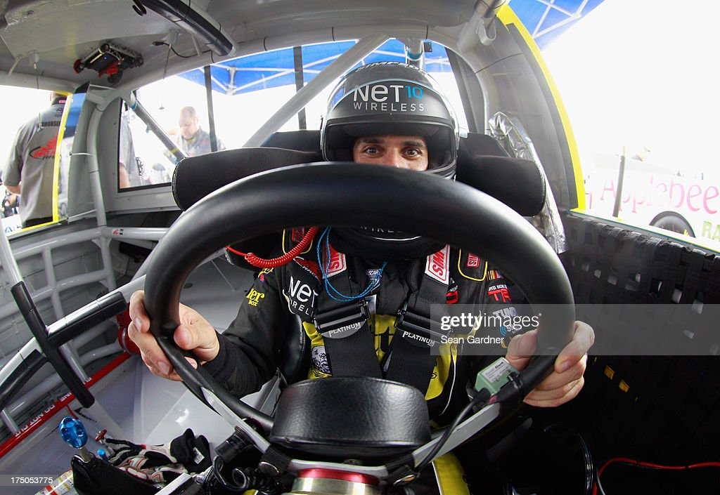 German Quiroga, driver of the #51 NET10 Wireless Toyota sits in his car during practice for the NASCAR Camping World Truck Series UNOH 225 at Kentucky Speedway on June 27, 2013 in Sparta, Kentucky.