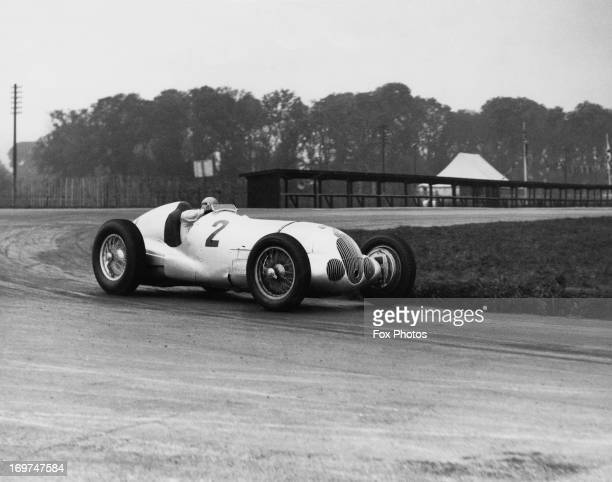 German racing driver Hermann Lang driving a MercedesBenz W125 in practice at Donington Park 30th September 1937 He is training with the DaimlerBenz...