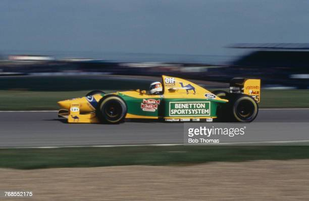 German racing driver Michael Schumacher drives the Camel Benetton Ford Benetton B193B Ford HB 35 V8 in the 1993 European Grand Prix at Donington Park...