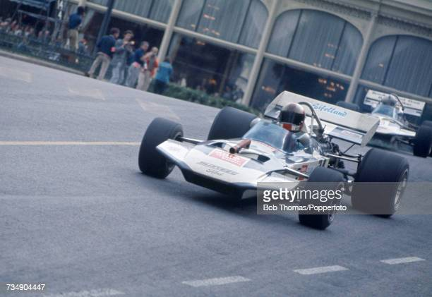 German racing driver Rolf Stommelen drives the Auto Motor und Sport Team Surtees Surtees TS9 Ford Cosworth DFV 30 V8 to finish in 6th place in the...